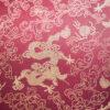 Tissu jacquard dragon bordeaux